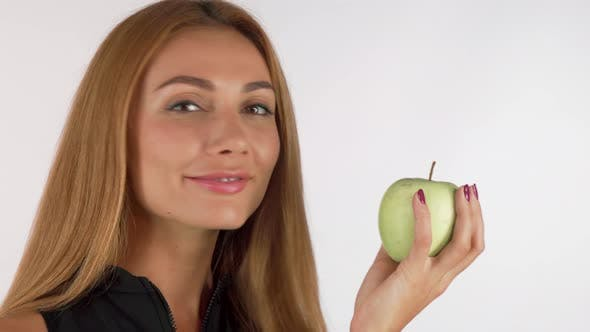 Thumbnail for Happy Woman Smiling Cheerfully Holding an Apple