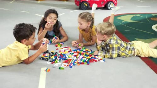 Cute Kids Playing Constructor on the Floor