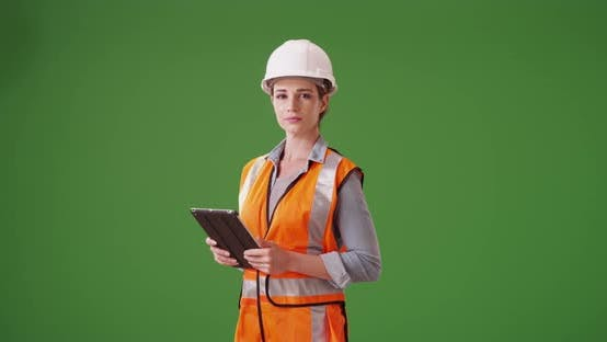 Thumbnail for Portrait of young woman construction manager on green screen
