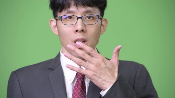 Young Asian Businessman Shocked
