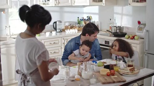 Interracial family in kitchen