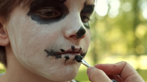 Thumbnail for Festive Skeleton Makeup for Teenage Boy