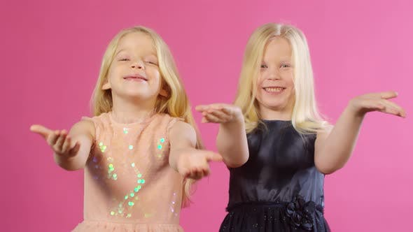 Thumbnail for Twins in Party Outfits Blowing Kisses