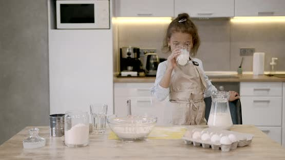 Mizedrace Girl Trying Cooking Alone in Kitchen