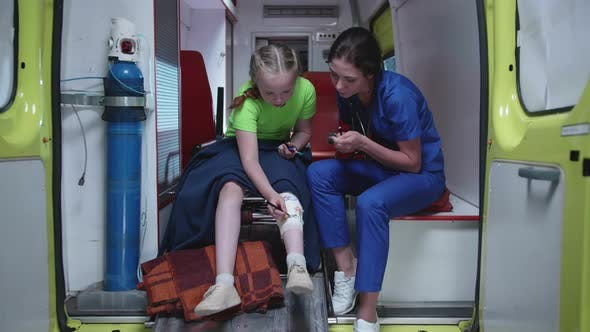 Thumbnail for Young Nurse and Sick Girl in Ambulance Car.