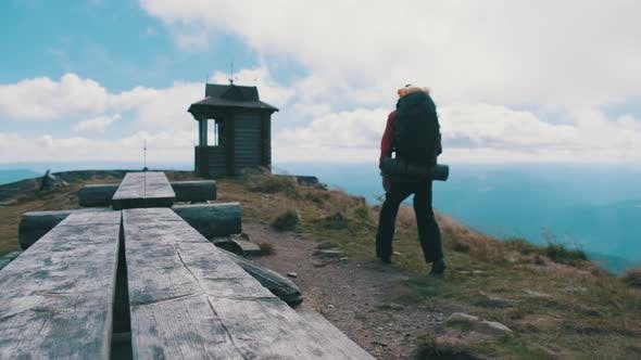 Thumbnail for Tourist with Backpack on the Top of Mountain Spreads His Arms To the Sides