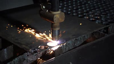 Plasma cutting of metal on an automatic laser machine. Laser cutter in the production.