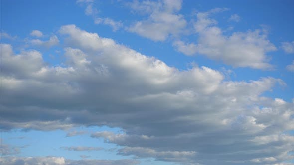 Beautiful Cumulus Clouds Move Fast Across the Blue Sky, Timelapse. Beauty of Nature Colors