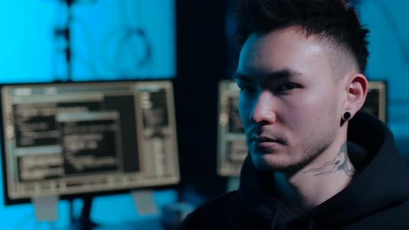 Thumbnail for Asian Hacker in Dark Room with Computers at Night 45
