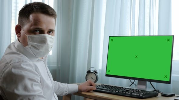 Thumbnail for Business man in medical mask looking seriously to camera
