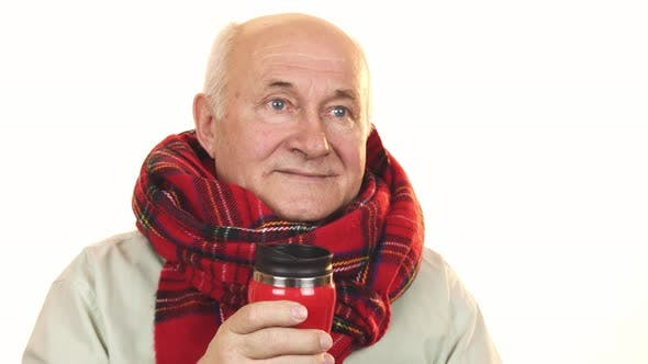 Thumbnail for Cheerful Senior Man Wearing a Scarf Holding Thermos Smiling Happily
