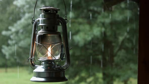Thumbnail for Rain Water Dipping from the Roof Edge with Old Oil Lantern