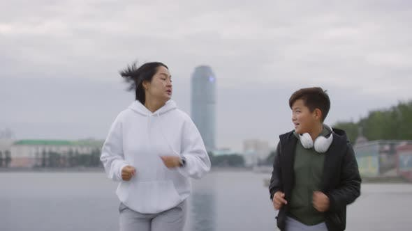 Thumbnail for Asian Boy Running with Mom in the Morning