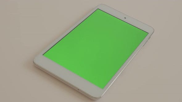 Thumbnail for Tablet PC  with green screen display on white surface 4K 2160p UltraHD footage - Silver PC tablet co