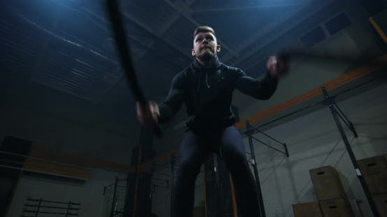 Thumbnail for Young Man Training with Battle Rope