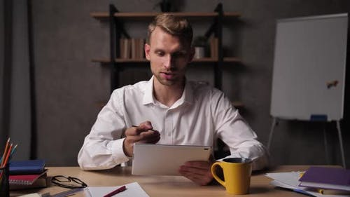 Businessman Analyzing Business Report Online