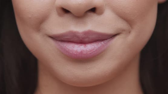 Close Up of Female Smiling Lips with Pink Lipgloss
