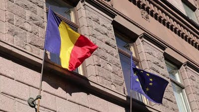 Romania Flag and European Union Flag Side By Side Fluttering in the Wind