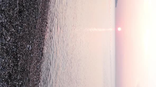 Vertical Video Dawn Over the Sea Aerial View