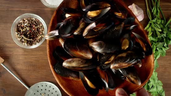 A Plate of Boiled Mussels Put on the Table.