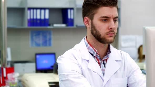 Thumbnail for Man Uses Computer at the Laboratory