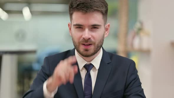 Thumbnail for Assertive Young Businessman with Pointing at the Camera