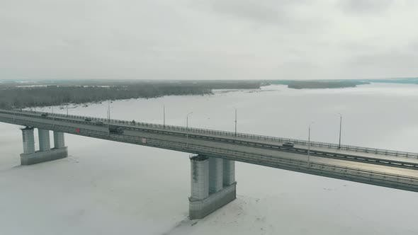 Thumbnail for Flycam Films Tremendous Bridge with Pylons Over Winter River