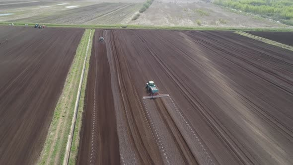 Thumbnail for Tractor on Agricultural Lands Is Cultivated with Fertilizers