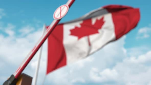 Thumbnail for Closing Boom Barrier with STOP CORONAVIRUS Sign Against Canadian Flag