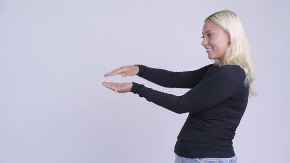 Thumbnail for Young Happy Blonde Woman Snapping Fingers and Showing Something