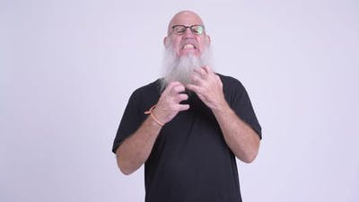 Sad Mature Bald Bearded Man Getting Bad News