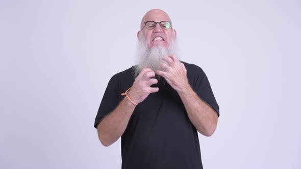 Sad Mature Bald Bearded Man Getting Bad News