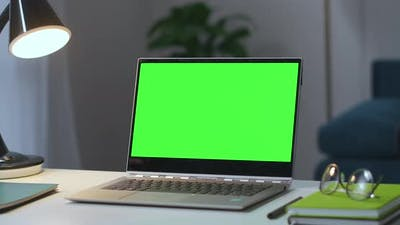 Open Notebook with Chroma Key Screen on Working Table in Empty Living Room Zooming Shot Approaching