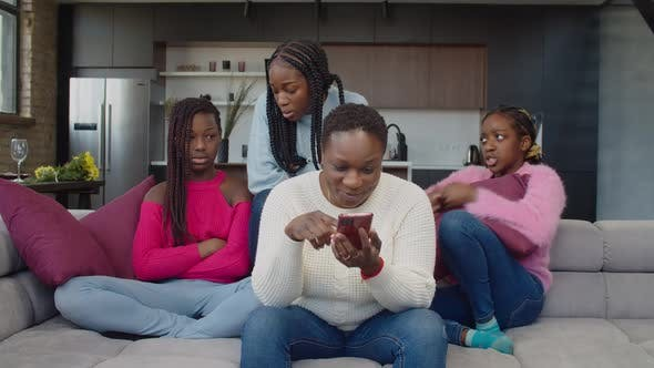 Addicted to Phone Mother Ignoring Upset Daughters