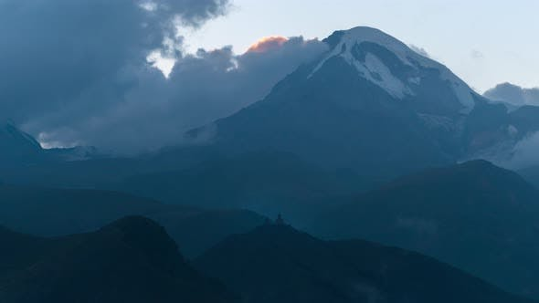 Thumbnail for Mystical Alpine Landscape. View of Snow-capped Peak Mount Kazbek, Ravines, Church on Top of a Hill