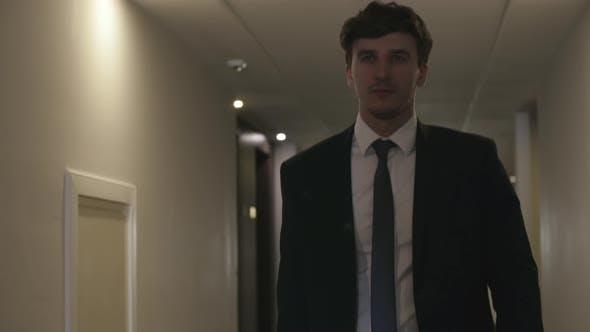 Thumbnail for Businessman Going through Hotel Corridor