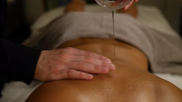 Thumbnail for Young Beautiful Slim Woman Getting Legs Massage with Oil in Resort Spa Salon. Girl Receiving Body