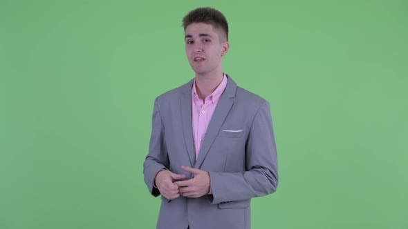 Thumbnail for Happy Young Businessman Talking To Camera