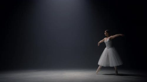 Sensual Ballerina Jumping on Stage
