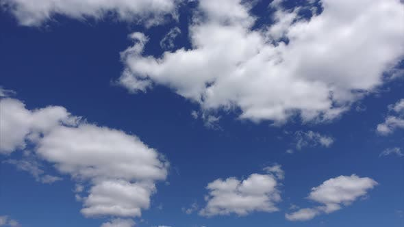 Thumbnail for Timelapse Shot of Beautiful Clouds in the Atmosphere. Blue Heaven with White Clouds in the Summer