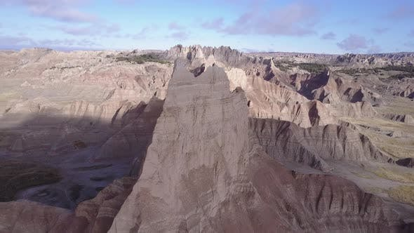 Thumbnail for Dramatic Aerial Drone Circling Badlands Peak or Spire Geology and Topograpy Landform in America West