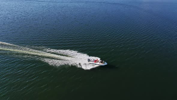 Motorboat on blue water surface