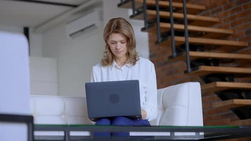 Candid Business Woman Typing on Computer