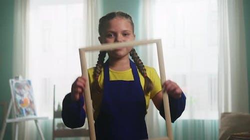 Creative Portrait of Smiling Girl Artist