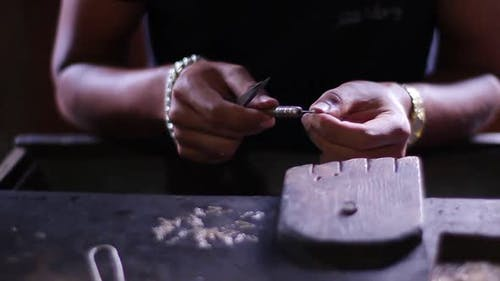 Jeweler Produces the Silver Chain.