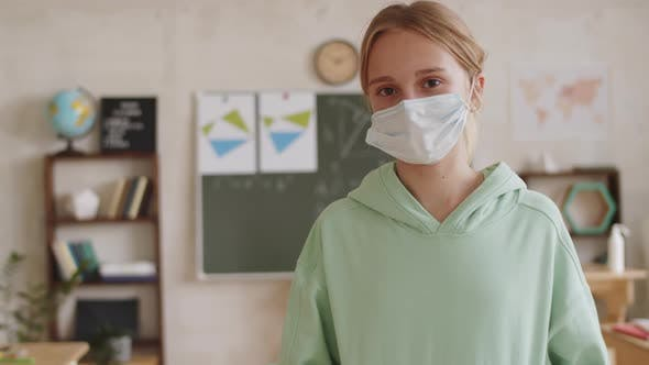 Thumbnail for Portrait of Caucasian Schoolgirl in Face Mask in Classroom
