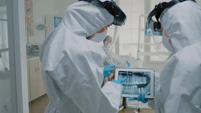 Professional Dentists Using Technology for Oral Examination