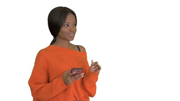 Thumbnail for Beautiful Afro Woman Using Smart Phone Technology App On