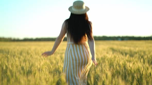 Thumbnail for Beauty Girl with Long Hair in Dress Running on Wheat Field in Sunset Summer, Freedom Concept
