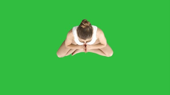Thumbnail for Young woman meditating in Lotus Pose on a Green Screen, Chroma Key